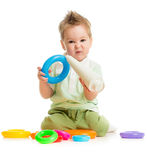 Baby playing colorful toys stock photo
