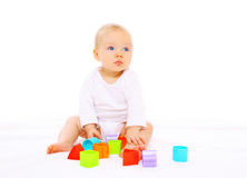 Baby playing with colorful toys on white Stock Photos