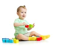 Baby playing with colorful wood building blocks Royalty Free Stock Images