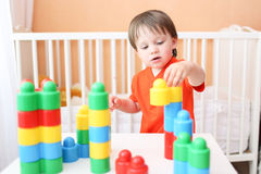 Baby playing constructor at home Royalty Free Stock Image