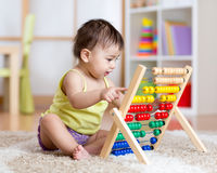 Baby playing with counter toy Royalty Free Stock Photo