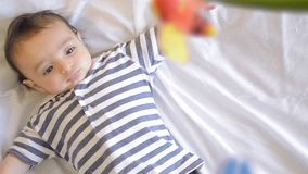 Baby playing in the cradle stock footage