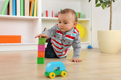 Baby playing with cubes and bricks Royalty Free Stock Image