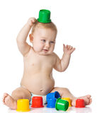Baby playing with cup toys. Stock Images