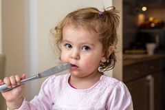 Baby playing with a dangerous knife Royalty Free Stock Photography