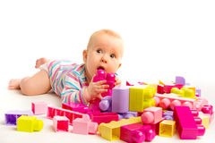Baby playing in designer toy blocks. A baby playing in designer toy blocks stock photos