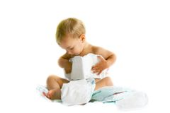 Baby playing with diapers royalty free stock photos