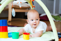 Baby playing and discovery Stock Image