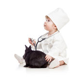 Baby playing doctor with pet bunny Stock Photography