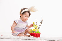 Baby playing with easter basket Stock Photography