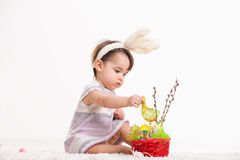 Baby playing with easter basket Royalty Free Stock Images