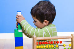 Baby is playing with educational toys Royalty Free Stock Photo