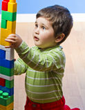 Baby is playing with educational toys Stock Photos