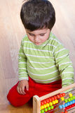 Baby is playing with educational toys Royalty Free Stock Images