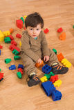Baby playing in empty room Royalty Free Stock Photo