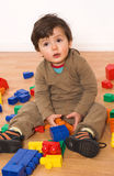 Baby playing in empty room Stock Images