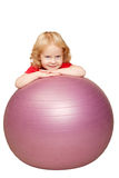 Baby playing with fitness ball. Royalty Free Stock Images
