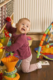 Baby playing on the floor Stock Photography