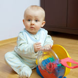 Baby playing on the floor. Baby boy playing with blocks on the floor royalty free stock image