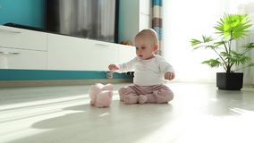 Baby playing on the floor stock video footage