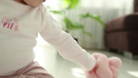 Baby playing on the floor stock footage