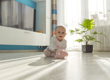Baby playing on floor Stock Images