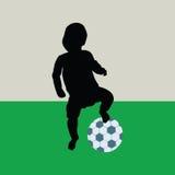 Baby playing football Royalty Free Stock Photo