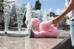 The baby is playing at the fountain royalty free stock photos