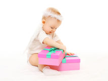 Baby playing with gift boxes on white background Stock Photos