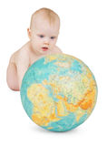 Baby playing with globe of earth Stock Photography