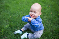 Baby playing in grass Royalty Free Stock Photo