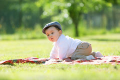 Baby playing on the grass Royalty Free Stock Image