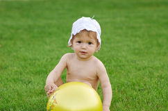 Baby playing on green lawn Royalty Free Stock Photos