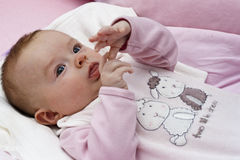 Baby playing with hands Royalty Free Stock Photos