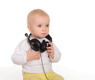 Baby playing with headphones on white background Stock Photography