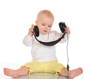 Baby  playing with headphones on white background Royalty Free Stock Photo