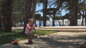 Baby playing with a helicopter. It parses the toy apart and rejoices stock footage