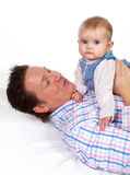 Baby playing with her daddy Royalty Free Stock Photos