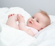 Baby playing with his feet Royalty Free Stock Photo