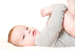 Baby playing with his feet Royalty Free Stock Photos