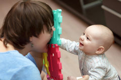 Baby playing with his mother Royalty Free Stock Images