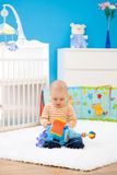 Baby playing at home stock photography