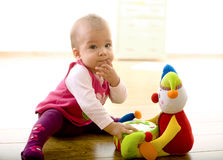 Baby playing at home Stock Image