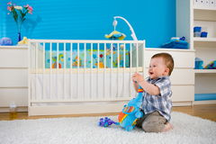 Baby playing at home Royalty Free Stock Images