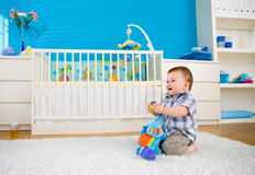 Baby playing at home Stock Images