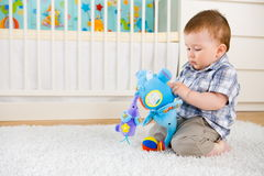 Baby playing at home Stock Photos