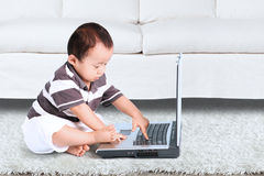 Baby playing laptop computer Royalty Free Stock Image