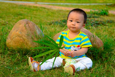 A baby playing on the lawn(Asia, China, Chinese) Stock Photo