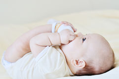 Baby playing with legs Royalty Free Stock Photo