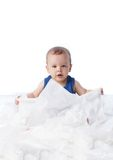 Baby playing with lots tissue papers Royalty Free Stock Image
